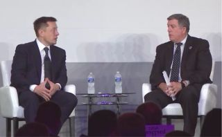 Elon Musk (left) talks to NASA International Space Station (ISS) program manager Kirk Shireman on July 19, 2017, at the ISS Research and Development conference in Washington, D.C.