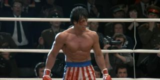 Rocky IV Sylvester Stallone stands in the ring, a little beaten up