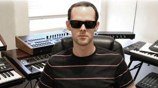 Steve Hauschildt wearing sunglasses in his studio