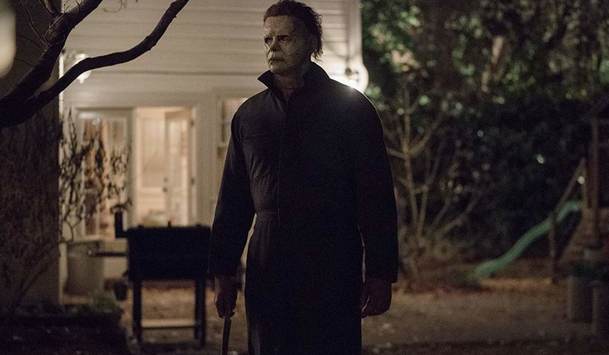 Halloween Michael Myers stands in someone's backyard