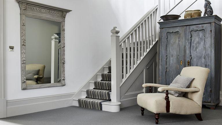 Grey hallway ideas by Carpetright with ornate mirror idea, cream armchair and wardrobe