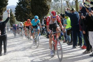 Lotto Soudal's Tim Wellens leads Astana's Jakob Fuglsang and CCC Team's Greg Van Avermaet at the 2019 Strade Bianche