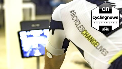 Rider from Qhubeka Assos using Supersapiens continous glucose monitor whilst riding on a turbo trainer
