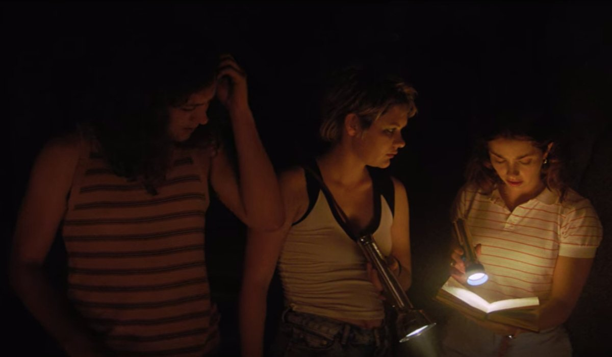 Arnie, Alice, and Cindy read a journal in Fear Street: Part 2 - 1978.