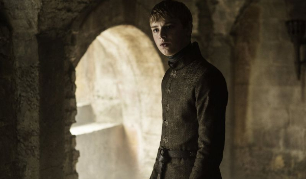 Game of Thrones King Tommen looks upset in a stone enclosure