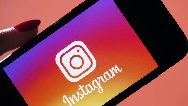 In this photo illustration, the social media application logo, Instagram is displayed on the screen of an iPhone on March 15, 2019, Instagram Swipe Up