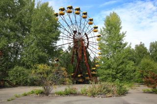 A ferris wheel sits unused in an amusement park that never opened in the abandoned Pripyat city within Chernobyl's exclusion zone.