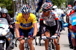 2004 Tour de France race leader Lance Armstrong forces Italian rider Filippo Simeoni back to the bunch as 'punishment' for having testified against Dr Michele Ferrari