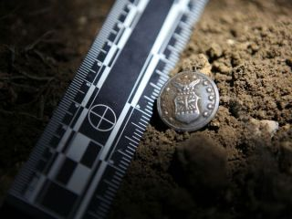 A military button found at a famous UFO crash site.