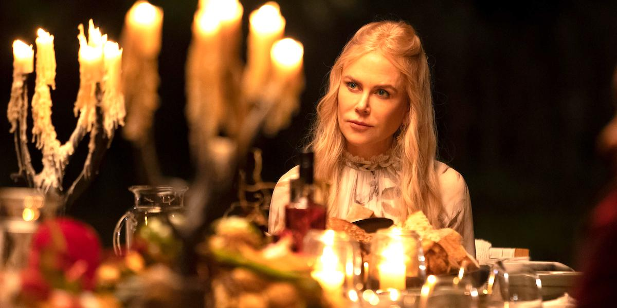 Nicole Kidman (Masha) sits in candlelight at Tranquillum House in Nine Perfect Strangers