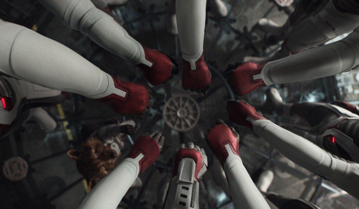 Avengers putting their hands in Avengers Endgame