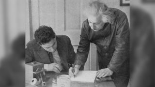 Albert Einstein stands with a student, circa 1945. The theoretical physicist was known to correspond with random people who wrote to him, according to researchers of a new study describing a letter he wrote to an engineer in the British Royal Navy.