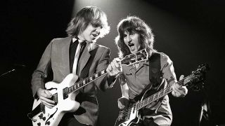 Alex Lifeson and Geddy Lee performing live onstage on Exit...Stage Left tour