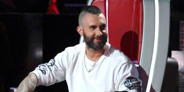 adam levine smiling the voice chair