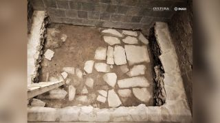Archaeologists found the remains of a basalt slab floor from the Aztec palace.