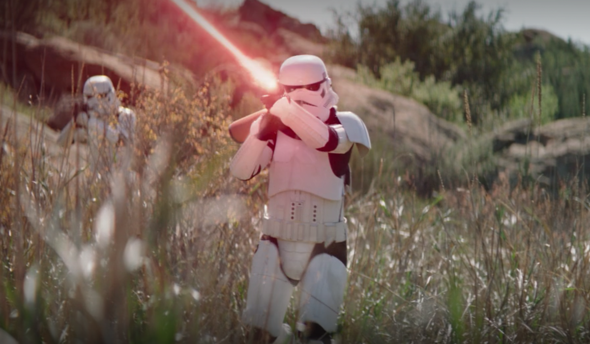 the mandalorian stormtrooper shooting blaster