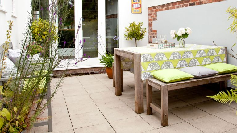 patio area with table and bench