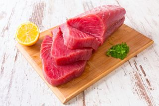 A raw tuna steak on a cutting board