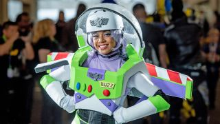 A fan cosplays as Buzz Lightyear from Toy Story during the 2018 New York Comic-Con.