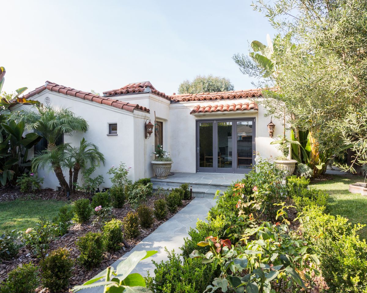 Take a turn around this modernized Spanish-style bungalow decorated in pure white