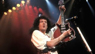 Brian May, Red Special guitar in hand, performs live in 1993