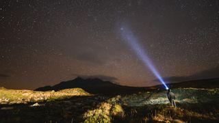 man hiking at night
