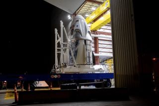 A SpaceX Crew Dragon spacecraft arrives at Launch Complex 39A at NASA's Kennedy Space Center in Florida, transported from the company's processing facility at Cape Canaveral Air Force Station on Friday, May 15, 2020, in preparation for the Demo-2 flight test.