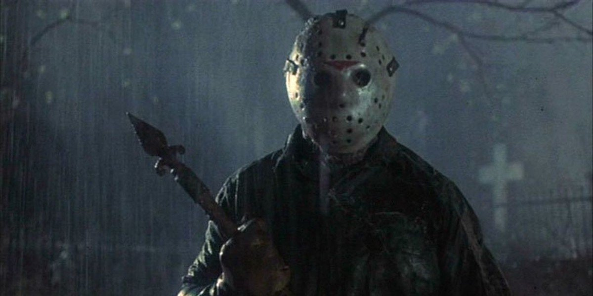 Jason Voorhies stands in the rain holding a weapon in 'Friday the 13th'