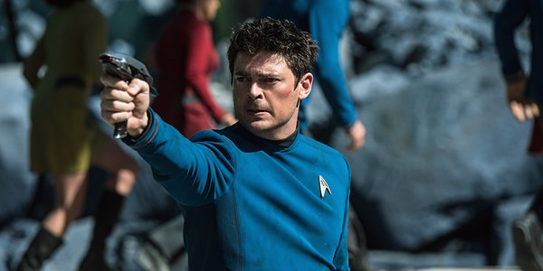 Karl Urban's Doctor Bones McCoy firing a phaser in Star Trek Beyond
