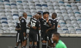 Fortune Makaringe of Orlando Pirates celebrates goal with teammates