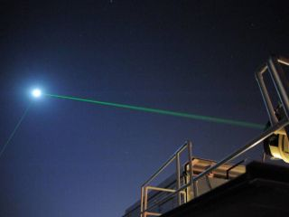 This photograph shows the laser-ranging facility at the Goddard Geophysical and Astronomical Observatory in Greenbelt, Maryland trying to hit the Lunar Reconnaissance Orbiter (LRO) with green laser light. For the first time, another facility in Grasse, France successfully bounced a laser (using infrared light) off the LRO's onboard mirror.