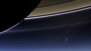 This rare image taken on July 19, 2013, by NASA's Cassini spacecraft has shows Saturn's rings and our planet Earth and its moon in the same frame.