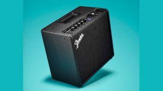 Fender Mustang LT25 practice amp on a blue background