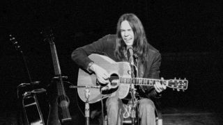 Neil Young performs at the Royal Festival Hall, London in 1971