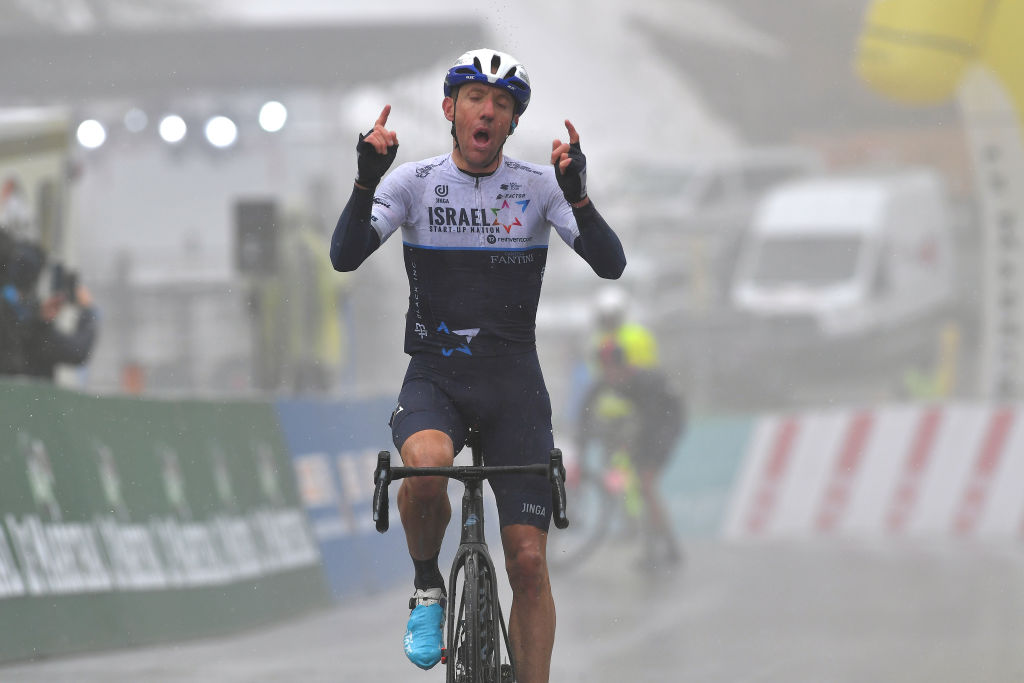 THYON 2000 LES COLLONS SWITZERLAND MAY 01 Michael Woods of Canada and Team Israel StartUp Nation celebrates at arrival during the 74th Tour De Romandie 2021 Stage 4 a 1613km stage from Sion to Thyon 2000 Les Collons 2076m TDR2021 TDRnonstop UCIworldtour on May 01 2021 in Thyon 2000 Les Collons Switzerland Photo by Luc ClaessenGetty Images