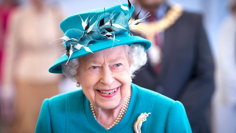 Queen Elizabeth II smiles during a visit to the Edinburgh Climate Change Institute