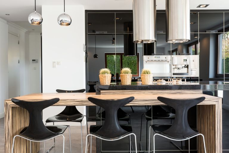 best kitchen lighting: Black and natural timber kitchen with cactus planters