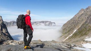 man enjoying a mountain view