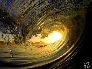 a yellow sunset and a wave near Monterey, California