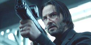 John Wick Keanu Reeves aims a cool looking gun