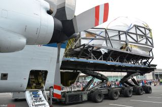 Space shuttle flight simulator arrives in Seattle.