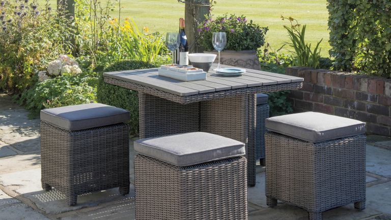 compact outdoor dining set with table and stools