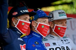 Riders wear face masks on the podium at the Oxyclean Brugge - De Panne