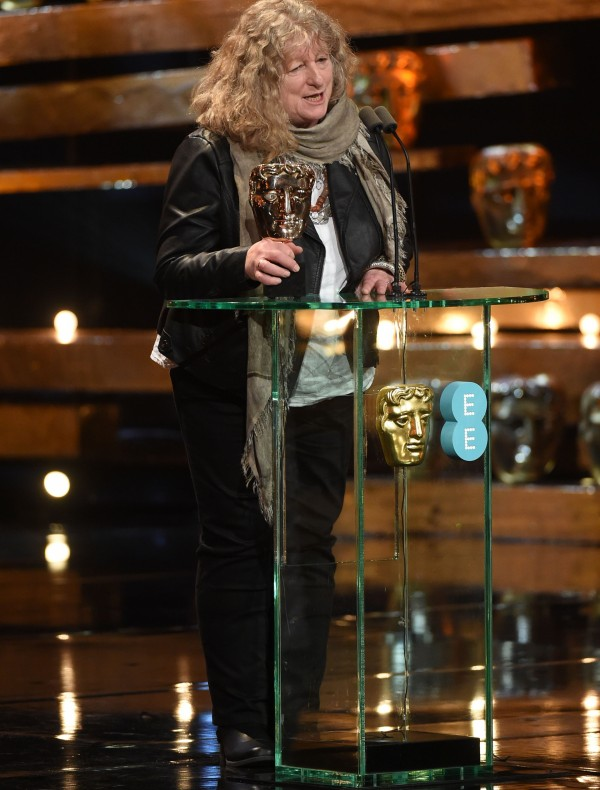 Jenny Beavan on stage with her Bafta (Jonathan Hordle/REX Shutterstock)