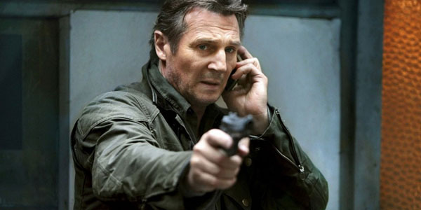 Liam Neeson pointing a gun in Taken