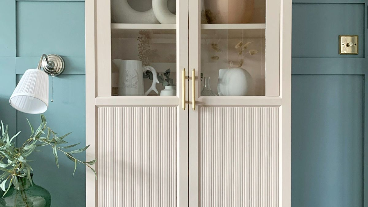 The iconic BILLY bookcase has been turned into a boutique cabinet in this stylish transformation