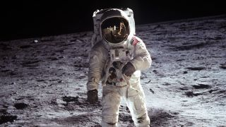 Astronaut Buzz Aldrin walks on the lunar surface.