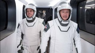 NASA astronauts Bob Behknen (left) and Doug Hurley will be the first to fly on SpaceX's Crew Dragon spacecraft during the Demo-2 mission. It could launch in Spring 2020. Here, they walk through the access arm in a dress rehearsal for launch during SpaceX in-flight abort preparations.