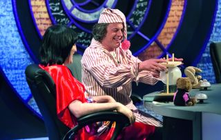 Sandi Toksvig, Alan Davies, Holly Walsh, David Mitchell and Noel Fielding are in pajamas and slippers and, in Alan's case, a nightcap.
