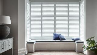 a bay window idea for built in seating and shutters